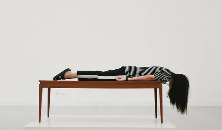 female-laying-on-top-of-table